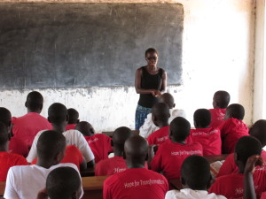 Stella speaks to female students at the island secondary school.